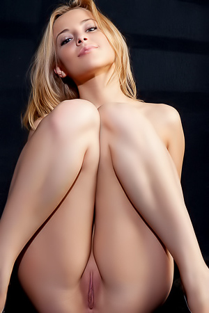 Blonde Nikia A is posing naked