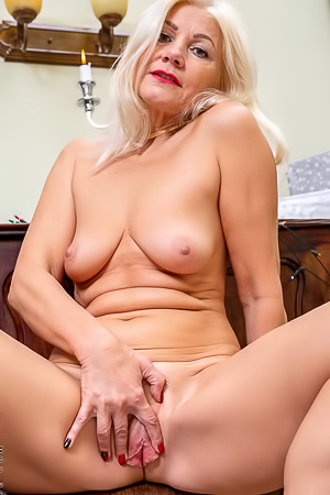 Sylvie Mature blonde Sylvie sits down on the piano naked