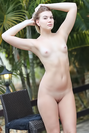 Cute blonde Sandra Frost looks a little shy as she makes her nude debut