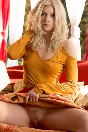 Blonde Arya Fae lifts up her dress to show pussy